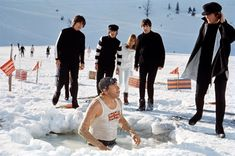"""17th March 1965. The Beatles and roadie Mal Evans film a running gag for """"Help!"""" in Austria'"""