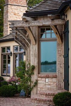 Reclaimed Timber Beams on the exterior of a Rustic Ranch Style Home designed by talented architect, Mitch Wise Design