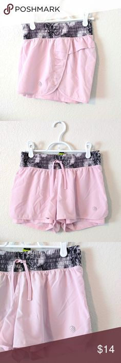 MPG Pink Running Shorts MPG Pink Running Shorts Pale pink w/Gray print at waist Features inside short liner, tie at waist. Cute detail on sides and back. Size Small (run a bit small in my opinion) EUC MPG Shorts