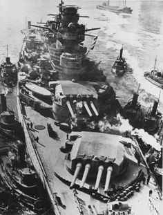 Battleship Richelieu arriving in New York for refit. The fire control director on the fore tower had to be dismantled for her to pass under the Brooklyn Bridge. Note damaged turret.