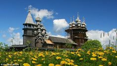 Idyllic: The stunning religious buildings are topped with 22 domes called cupolas (150 year old Russian Orthodox Church built of wood, even the nuts and bolts)