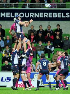 Right locks Melbourne Rebels Hugh Pyle (R) and South African Bulls Juandre Kruger (L) leap for the ball during the final stages of the Super Rugby match in Melbourne on May 4, 2012.