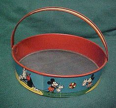 Early Disney Mickey Mouse Sand Sifter.  Can't remember if mine was a Disney, but I sure loved it!