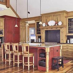 Rustic Red Kitchen Cabinets love the cabinets, wood beams and stone fireplace. i also like the