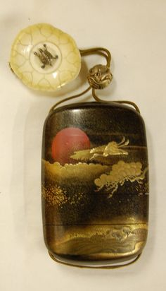 Japanese inro (5 case). Cranes and pine tree by water and rising sun. Made of makie lacquer -- Turtle. Netsuke (Manju), made of ivory, gold.