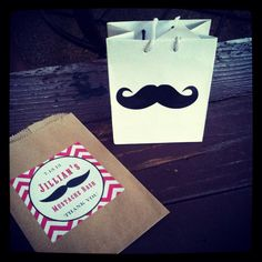Getting ready for Mustache Themed Girl's Birthday Party, candy/desserts bags for guests.