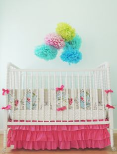 Looking for a pop of hot pink in the nursery? We love this super-sweet crib bedding from @tushiestantrums. #PNpartner