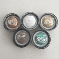 Five maybelline color tattoo eyeshadows Set of five brand new, never opened maybelline color tattoo eyeshadows. Colors included: bad to the bronze, too cool, bold gold, tough as taupe & edgy emerald. These shadows are long lasting, very pigmented & don't crease even without a primer. Maybelline Makeup Eyeshadow