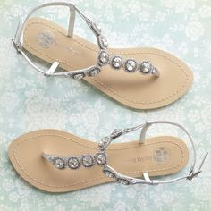 - Helia - Thong sandals - Classic design - Rows of sparkling floating Halo sparkles - Light blue outsole for your 'something blue' - Muted silver color - Adjustable buckle closure - Genuine leather up