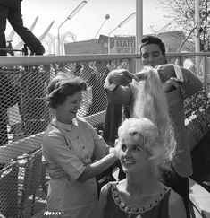 """""""It Happened at the World's Fair"""" - Behind-the-Scenes Photo    Elvis Presley as Mike Edwards holding hair of woman while hair stylist looks on."""