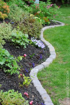 The Perfect Border for Your Beds: Defining a Garden s Edge With Stone-more expensive than pebbles or cutting an edge with a spade but way cleaner and easier to mow