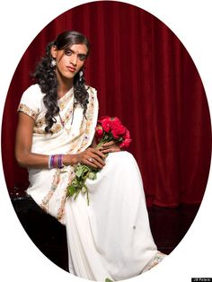 This hijra is in a traditional 'bridal' gown. They are about to go through the traditional 'wedding.' -Rider