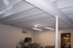 Great tutorial on how to paint a basement ceiling.