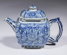 """DUTCH DELFT TIN-GLAZED EARTHENWARE TEAPOT, diminutive, having a short high spout, angled C-shape handle, paneled and fluted sides and cover, and intricately painted blue floral designs on sides and cover. Marked with what appears to be an overlapping """"JD"""". Likely Jan Dextra, Delft, Holland. 18th century. 4 3/4"""" H"""