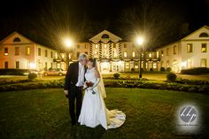Night winter wedding portrait in front of the Williamsburg Inn right before Christmas by Heather Hughes Photography. http://www.heatherhughesphotography.com/