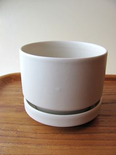 Mid Century Modern style white two piece flower pot S, model SN by Richard Lindh Arabia Finland. In production 1964-1985. Saucer has Arabia crown mark and text Arabia Finland.