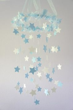 This would be fun to make.   http://www.artfire.com/ext/shop/product_view/LovebugLullabies/7229851/baby_blue_andamp_white_star_mobile_-_nursery_mobile_baby_shower_gift/handmade/children_s/babies/mobile