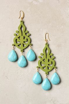 The contrasting color combo, shapes and finishes are really pleasing to the eye. (Carved Filigree Earrings | David Aubrey)