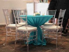 Simple cocktail table with Acrylic Chiavari Chairs. Seating Arrangement Wedding, Table Flower Arrangements, Seating Plan Wedding, Wedding Flower Arrangements, Yellow Wedding Flowers, Wedding Table Flowers, Wedding Table Settings, Blue Wedding, Sweet 16 Decorations