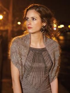 Knit this womens shrug with bobble stitch detail from Parisian Nights. A design by Marie Wallin using the beautiful Kidsilk Haze, a versatile fine yarn made from 70% mohair and 30% silk. This knitting pattern is suitable for intermediate knitters.