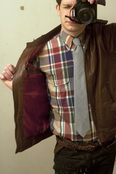 Brown leather jacket, muted madras shirt... not into the jeans and the belt...  #men #style #shirt #jacket