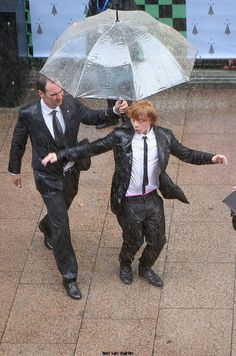 Rupert Grint dancing in the rain. This picture makes me happy.