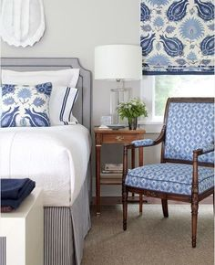 Love this blue and white bedroom and the headboard and skirt are fabulous!