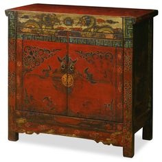 Hand-Painted Tibetan Cabinet.  This unique vintage cabinet is colorfully decorated to represent the exotic Tibetan culture and its expressive art style. The vibrant use of colors directly reflects the personality of Tibetan people who are passionate with life. Tibetan furniture.