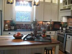 The Red Brick Cottage Country Primitive Show House tour; typical new build, beige walls, white trim, white kitchen, but country-primitive fixtures, lights, hardware, and furniture/decor. . . . full of great ideas, very warm and cozy but elegant and not too cluttered