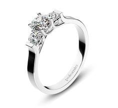 ZÁSNUBNÍ PRSTEN GRANADA Polomio Jewellery. Prsten Granada je prstenem se  skrytým překvapením –  prsten Granada. Shora jej zdobí centrální kámen, který má po stranách dva menší, neméně krásné kameny. Na bocích prstenu objevíte skrytá srdce………..jak víc lze vyjádřit své pocity? Zásnubní prsten je možné obědnat v červené, růžové, bílé a žluté barvě zlata. Zásnubní prsteny jsou osazeny zirkony, brilianty, nebo moisanity.