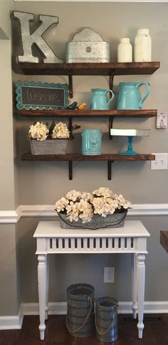 $40 - DIY Rustic Open Shelving #country chic #vintage home decor #rustic #Farmhouse This was so easy - and inexpensive! I bought a $12 board at Lowes and had them cut it to the length I needed. My husband stained the shelves the shade of our hardwood floors and island top and hung them for me. The brackets are from #Lowes as well, and the accessories are from #Kirklands #HobbyLobby and #Ross. We get compliments on the shelves all the time!