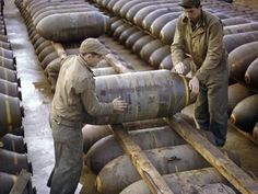 Photographic Print: Pair of American Servicemen Moving a Large Bomb at an Ammunition Dump During WWII : 24x18in