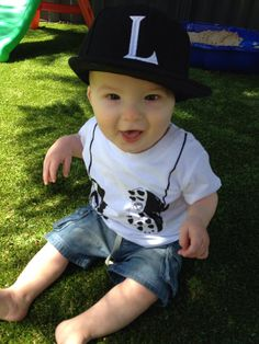 Super cute Louis wearing his Young and Moodie footy boots tee. Love the hat, little guy!