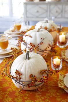 "Autumn Table Decor.  White pumpkins & bittersweet - secure bittersweet to pumpkins with floral ""u"" pins; sit atop fall table runner and add votives with small amounts of bittersweet for accent!"