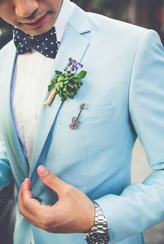 Groom in light blue suit with the polka dot bowtie