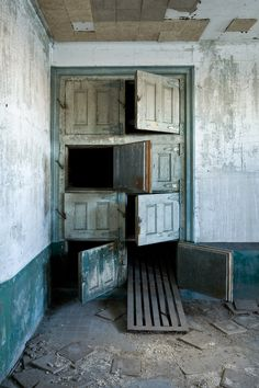This is the morgue in the Ellis Island Isolation Hospital, which occupies the abandoned southern 2/3 of the island.  Built in 1902, and abandoned in 1930, the hospital was primarily a waystation for immigrants who arrived and were judged ill - some were cured and allowed into the country, and many more were held in small rooms, many with views out to the Statue of Liberty, waiting for boats to deport them back to their countries of origin.  But for thousands, the hospital