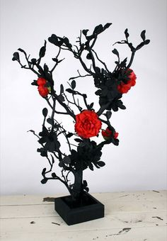 Black Manzanita Tree with Red Decor on top of a pillar for in front of the Sweetheart table