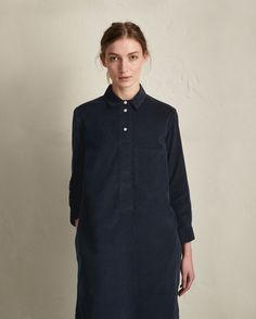 NEEDLECORD SHIRT DRESS | Shirt dress with large patch pocket in supple needlecord. Short, neat collar. Corozo shank buttons. Double buttoned cuff. Split side seams