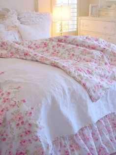 I would LOVE to have that duvet bedskirt and pillows. The little pink roses? So happy. So pretty. Aaron would just have to deal.