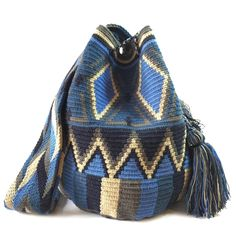 www.lombiaandco.com    All bags are made and purchased from the La Guajira,Colombia, where the indigenous Wayuu community live and crochet these beautiful mochila bags. #wayuumochilabag #doublethreadwayuubag