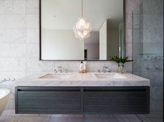These boutique apartments combine exceptional quality with one of Melbourne's most sought after addresses. Refined, sophisticated, tall and elegant, North Road Boulevard brings world class architecture and landscape design to one of Brighton's most exclusive locales. Using Silver White marble in both the kitchen and bathroom the large apartments exude contemporary, clean and luxurious ambience. White Marble, Bathroom Inspiration, Double Vanity, Brighton, Natural Stones, Landscape Design, Apartments, Melbourne, Bathrooms