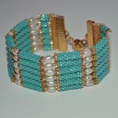 """Inspired by ancient Egyptian jewelry, this piece combines tubes of turquoise with freshwater pearls and a bright gold finished ball and snap closure. 7"""" x 1"""""""