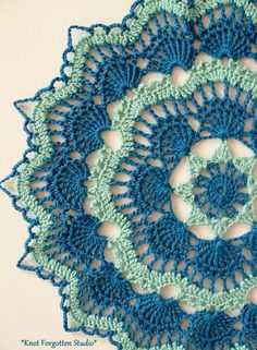 White Fan Doily~ Finished, January, 2015. I used Aunt Lydia's size 10 thread in Aqua and Blue Hawaii. The pattern is by Beth Mueller. This was a CAL. If you'd like to join in, go here: https://www.facebook.com/groups/730048977081281/ More