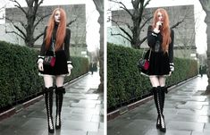 Olivia Emily wears Skinny Bags Dark Thoughts Clutch, River Island High Neck Top, Asos Ruffle Cuffs, Black Velvet Skirt, and Asos Lace Up Boots
