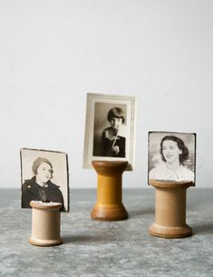 DIY: vintage wooden spool photo holders- Great idea for displays.