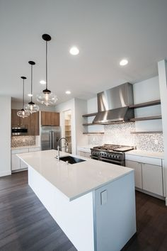 Modern Kitchen with European Cabinets, 2 in. Solid Surface Countertop in Venaro White, Kitchen island, Flush, Pendant light