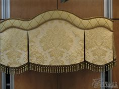 I love this fabric! curved cornice with box pleat bead trim #windowtreatments