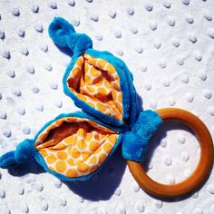 Organic Baby Toy Teething Wood Ring with Crinkle Bunny Ears Teether Accessory. $11.00, via Etsy.