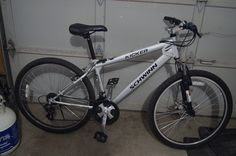 A pedal bicycle in a garage.