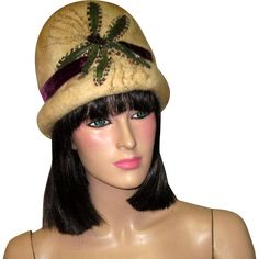 This is a superb, Art Nouveau/Art Deco wintry white toque hand-made, designed, hand-beaded and hand-embroidered depicting a wonderful dragonfly.  The